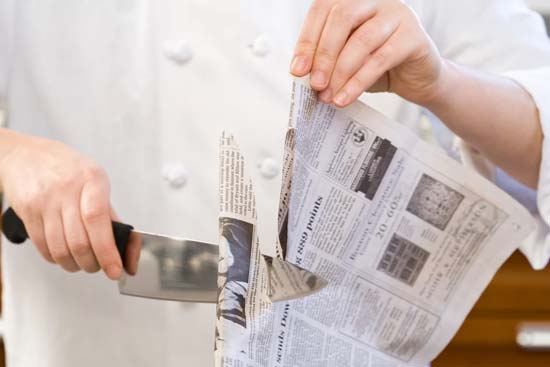 Use Old Newspaper To Clean The Burr Off The Knives