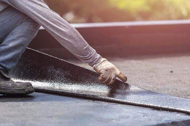 When should I replace my flat roof